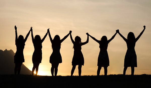group-of-women-holding-hands-aarp