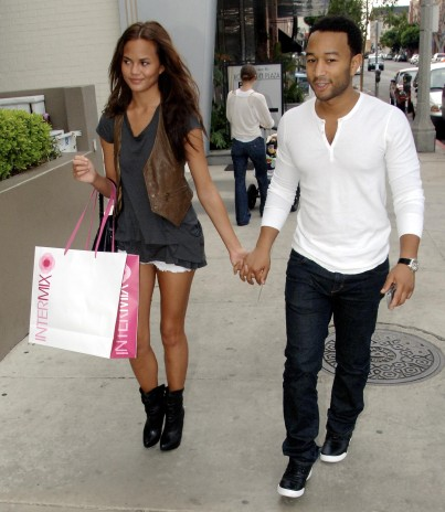 John Legend strolls along Robertson Boulevard in Beverly Hills, Ca with his girlfriend after shoppng at Intermix