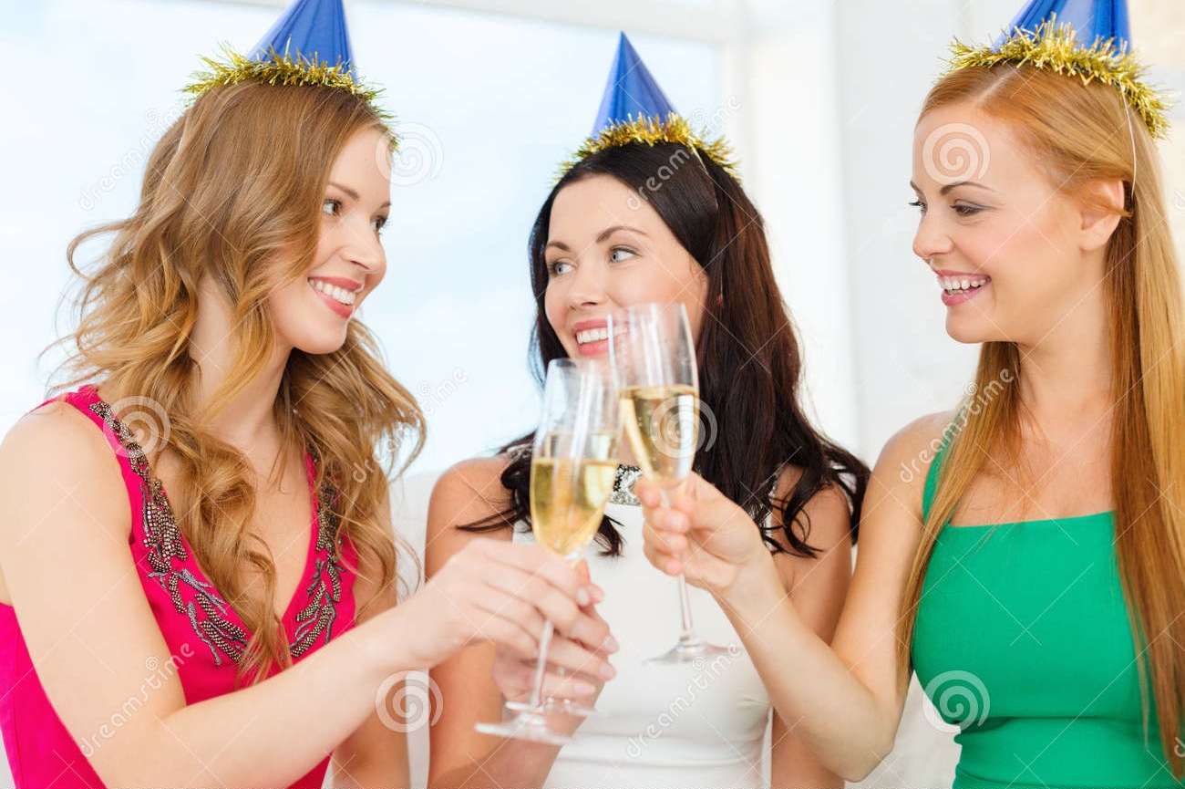 three-women-wearing-hats-champagne-glasses-celebration-drinks-friends-bachelorette-party-birthday-concept-smiling-blue-35013801