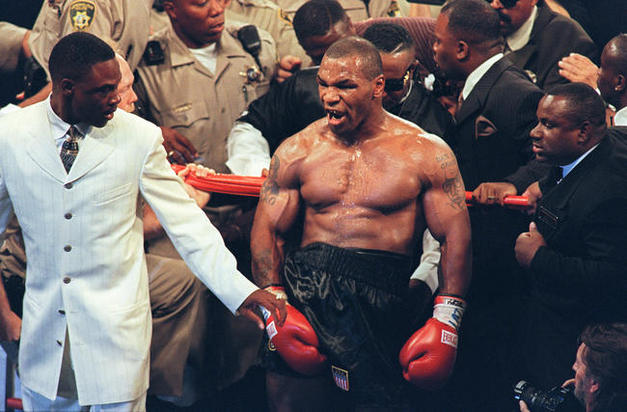Mike Tyson reacts after being disqualifi