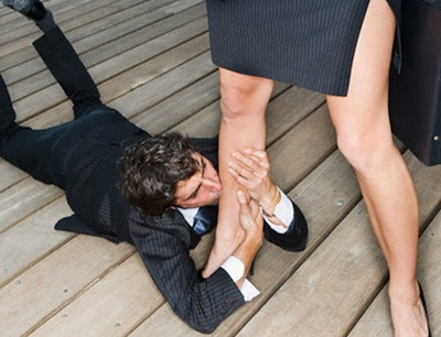 Businessman Kissing Businesswoman's Leg