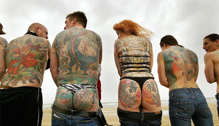 People with tattooed stand in line on Zandvoort beach in the north-west of the Netherlands.
