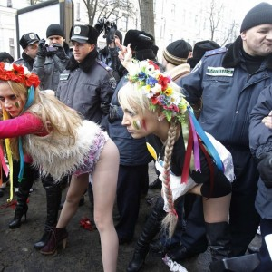 "Activists ""Femen"" take part in a protest against Italian Prime Minister Silvio Berlusconi in Kiev"