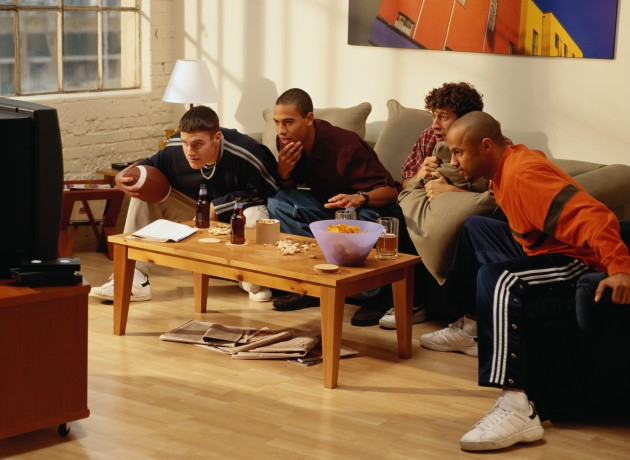 Four-Men-Watching-Football-on-TV-Credit-Ryan-McVay-AA003732-630x460