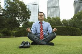 Man meditating outside - tie