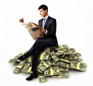 guy_sitting_on_money.282125903_large