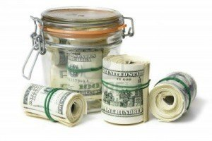 money-jar-filled-with-rolls-of-money