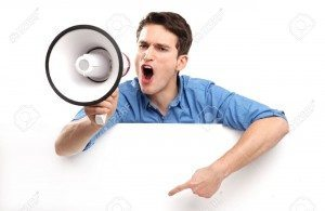 17604590-Guy-with-megaphone-and-white-board-Stock-Photo-megaphone-man-pointing