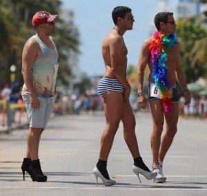 MIAMI BEACH, FL - APRIL 14: Juan Cuba Lorded, Teddy Fournier and Bob Micket (L-R) stand at the start line for the Azucar High Heel Race before the beginning of the Fifth annual Miami Beach Gay Pride Parade along Ocean Drive on April 14, 2013 in Miami Beach, Florida. The race participants according to the rules had to  wear high heels no less than 3 inches, approximatly 10 people entered the race to have a chance of winning the 1st place prize of $500.  (Photo by Joe Raedle/Getty Images)