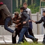 Migrants-jump-into-a-moving-lorry-in-Calais-297218