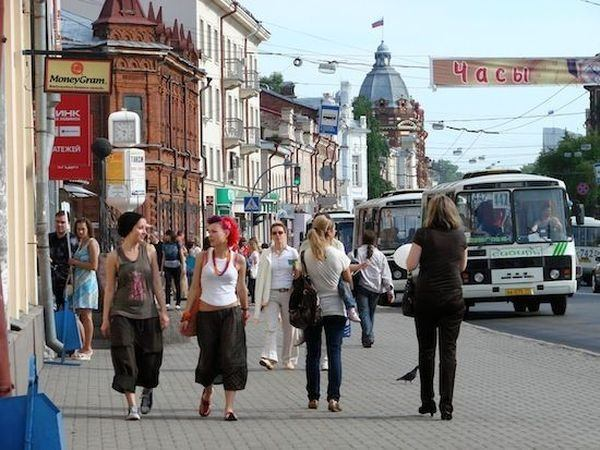 A street, somewhere in the former Soviet Union. Notice the look of the girl in blue, on the left