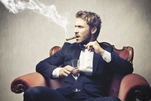 bigstock-boss-smokes-cigar-with-a-glass-43867087-300x200