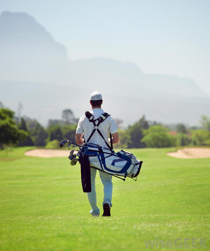 caddy-carrying-clubs-on-golf-course[1]