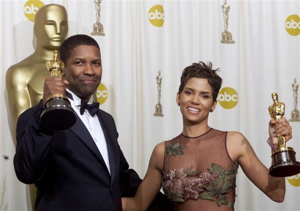 Actor Denzel Washington and actress Halle Berry appear backstage with their Oscar statues at the 74th annual Academy Awards in Hollywood in this March 24, 2002, file photo. REUTERS/Andy Clark/Files