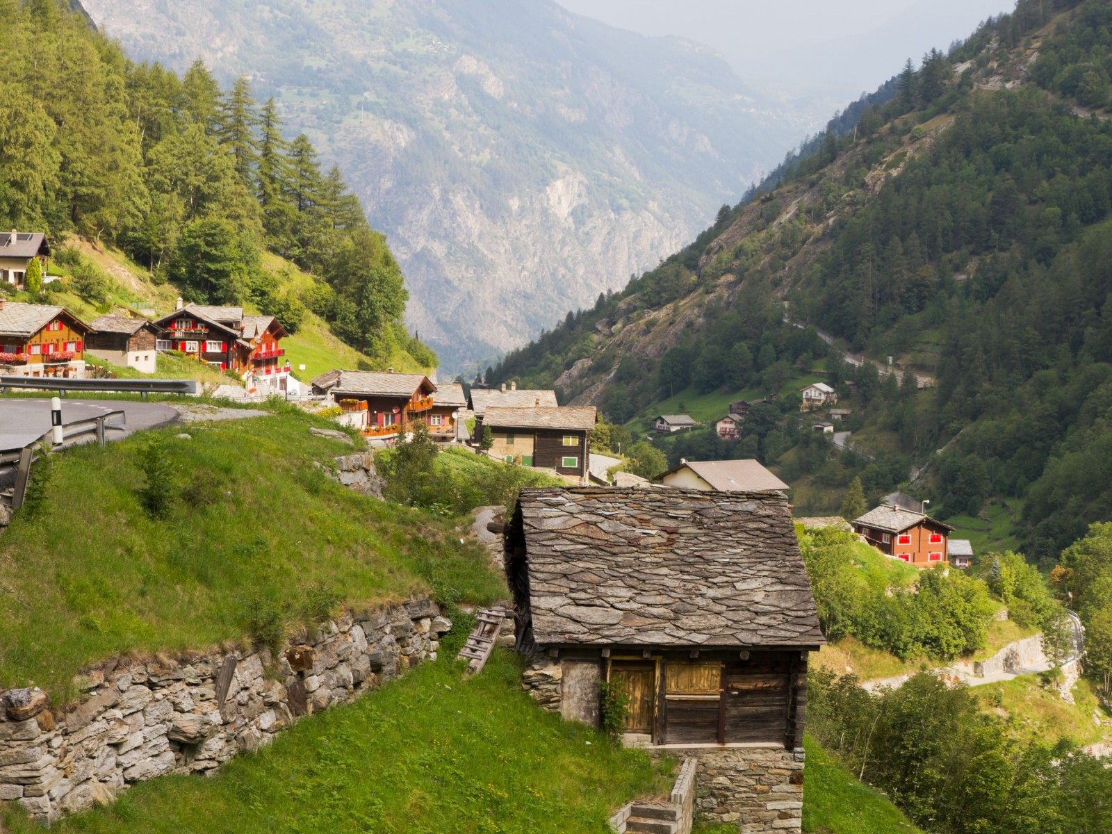 Travel-To-Switzerland-Small-Swiss-Village-Settlement-Saas-Balen-of-Wooden-Slate-Roof-Houses-in-Saas-Valley-Canton-Valais-Switzerland-1600x1200[1]