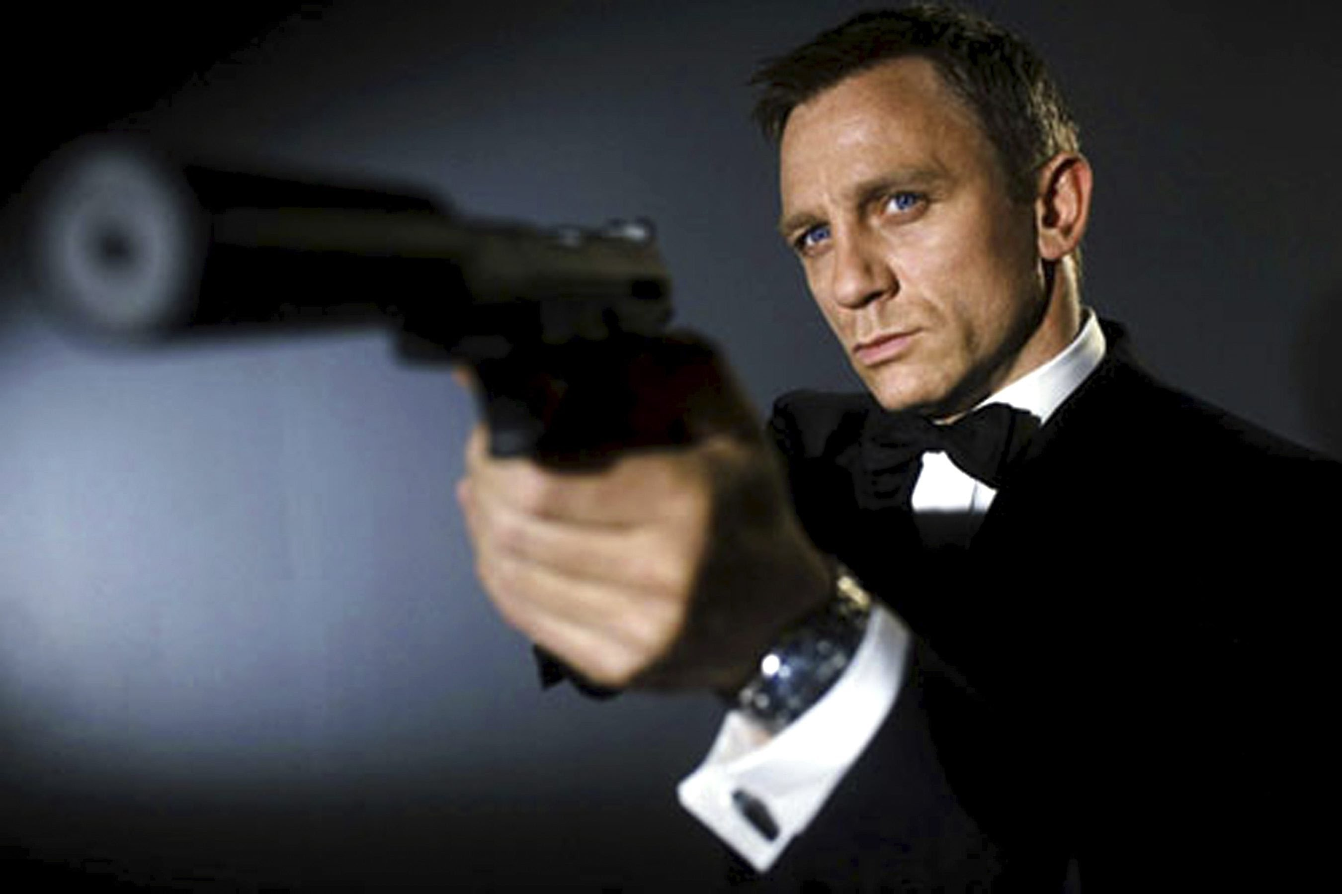 007 - a masculine hero. And yes that's a gun in his hand, Lena Dunham.