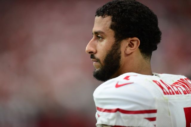 7162568_colin-kaepernick-weighs-in-on-donald-trump_e454d991_m