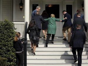 Hillary had to be carried up a flight of stairs as she sports Chairman Mao attire