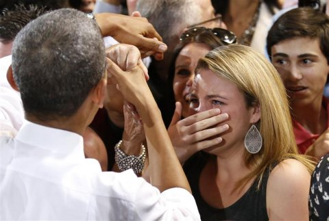 a-woman-cries-while-meeting-us-president-barack-obama-at-the-coral-reef-high-school-in-miami-florida-march-7-2014-reutersyuri-gripas