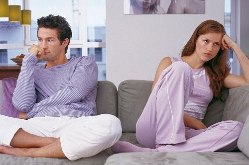 bored-couple-sitting-on-sofa-not-looking-at-each-other