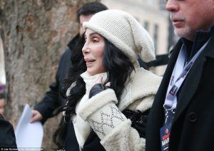 A decrepit Cher was thawed from her crypt and hauled down to the march